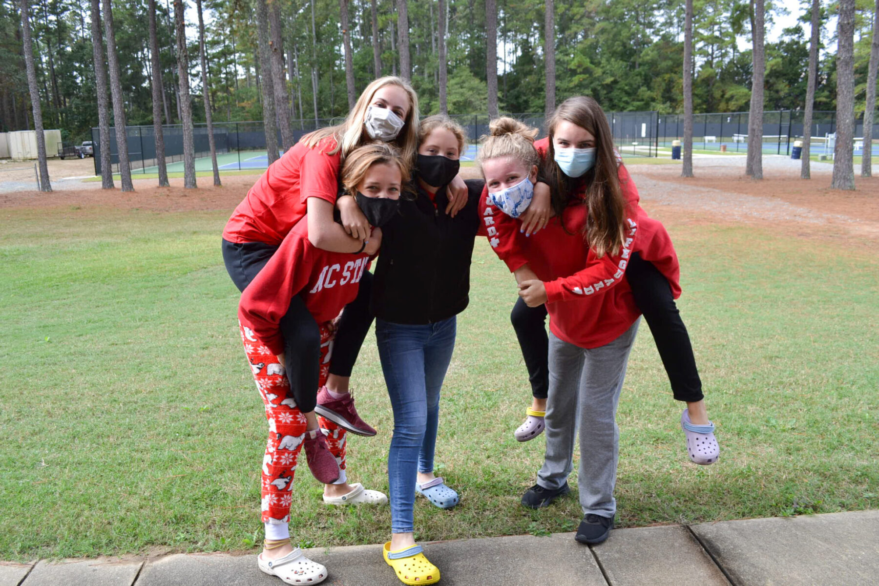 5 students in holiday pjs on the FA campus