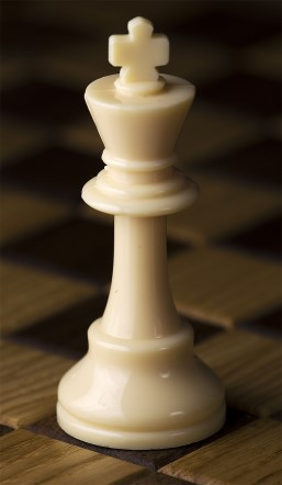 White Chess King Piece on chess board