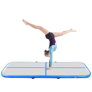 Gymnast doing a handstand on an airtrack