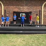 Students on an outdoor stage at Fayetteville Academy